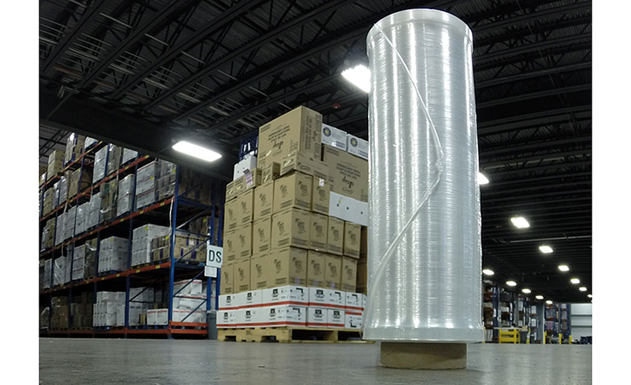 Roll of stretch wrap in front of pallet
