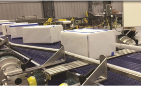 Multi-Conveyor builds mild steel constructed belt product turner conveyor system