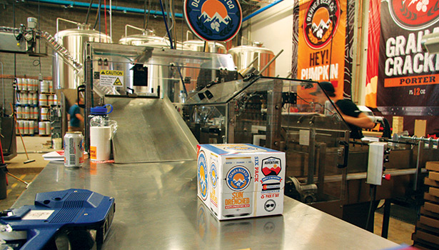 At Canworks, the Denver Beer Co. is packaging 6-packs of cold beer, in 12-ounce cans, in paperboard, end load cartons