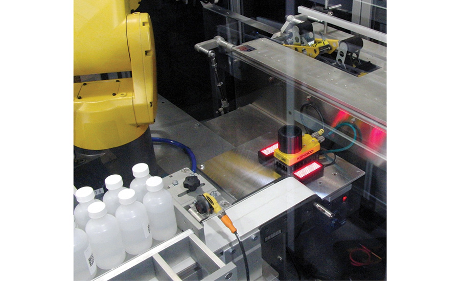The robot will pick the complete pack pattern and hold it over the camera to record the ID numbers of all the bottles before they are loaded into the case