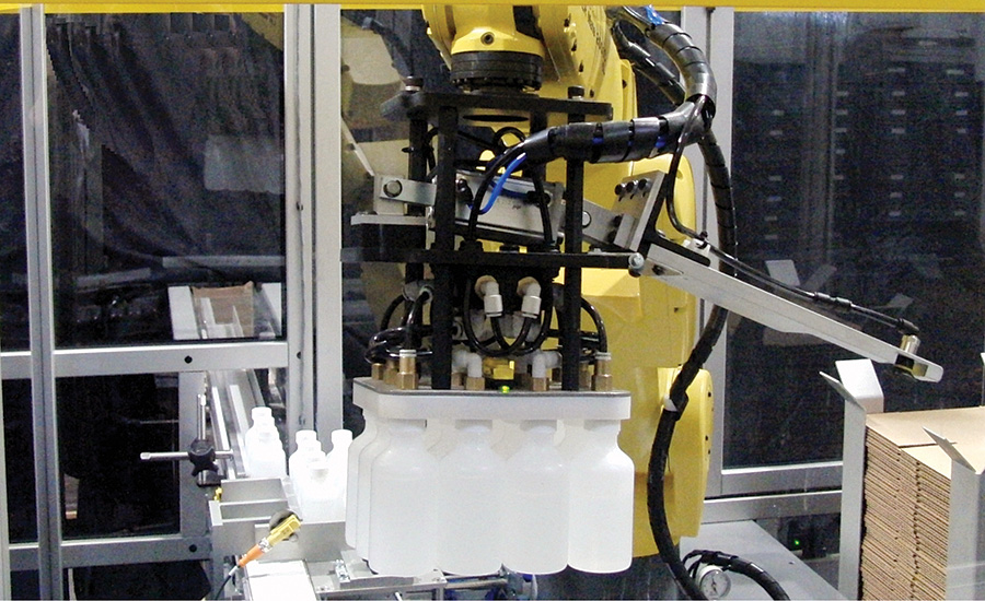 Custom ESS-designed robot end effector picks the complete pack pattern of bottles at one time