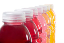 """Polyester bottles capable of withstanding """"hot fill"""" allowed juices, applesauce and other food and beverage products to drop the glass for """"safer"""" plastic."""