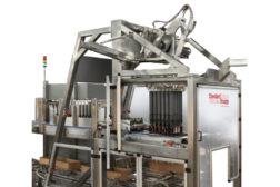 Pic N Place machine solves bottle breakage in partionless glass packing